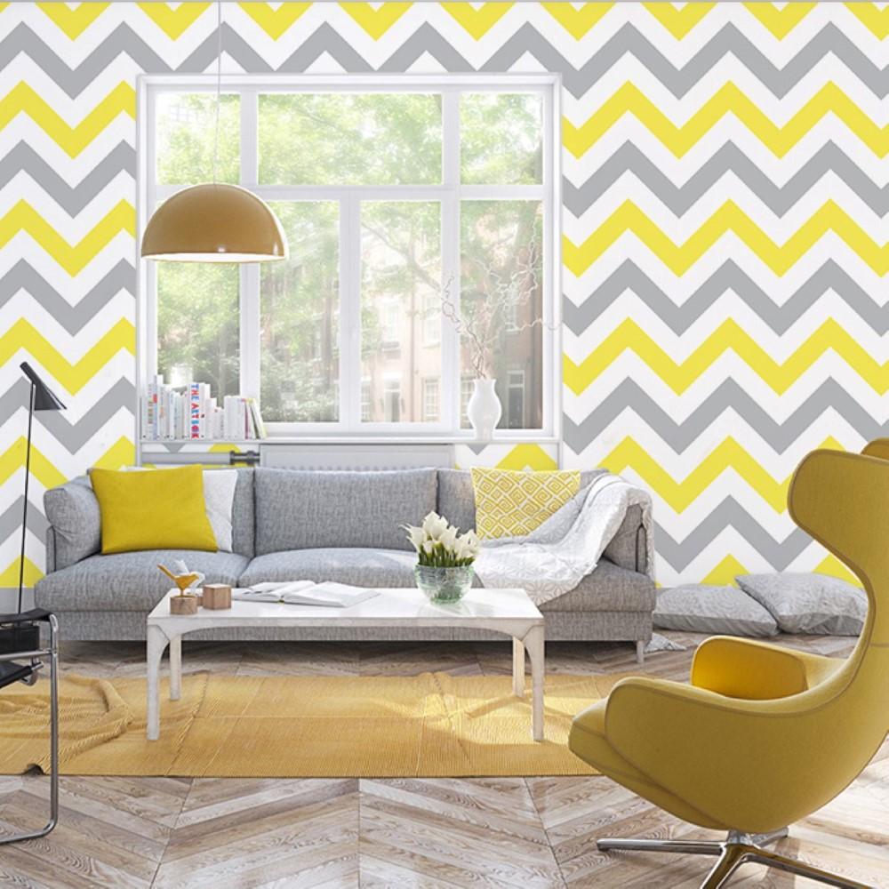 Papel de parede adesivo chevron amarelo e cinza stickdecor for Sala de estar com papel de parede 3d